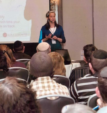 Rifka Lecturing in an event for Nefesh B'Nefesh, in the US.